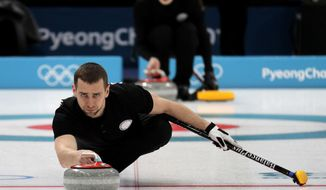 In this Feb. 7, 2018, file photo, Russian curler Alexander Krushelnitsky practices ahead of the 2018 Winter Olympics in Gangneung, South Korea. Russian curlers say a coach on their team told them that mixed doubles bronze medalist Krushelnitsky tested positive for a banned substance at the Pyeongchang Olympics. (AP Photo/Aaron Favila, File)