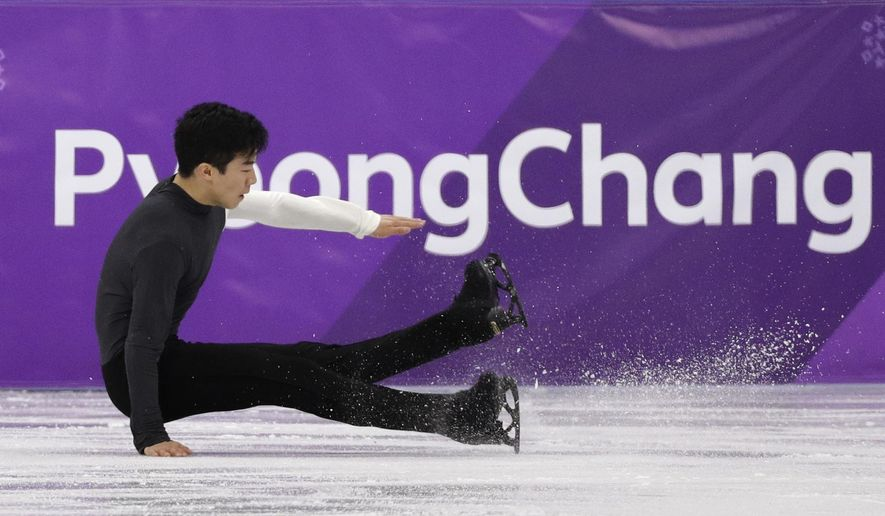 Nathan Chen of the United States falls while performing during the men's short program figure skating in the Gangneung Ice Arena at the 2018 Winter Olympics in Gangneung, South Korea, Friday, Feb. 16, 2018. (AP Photo/David J. Phillip)