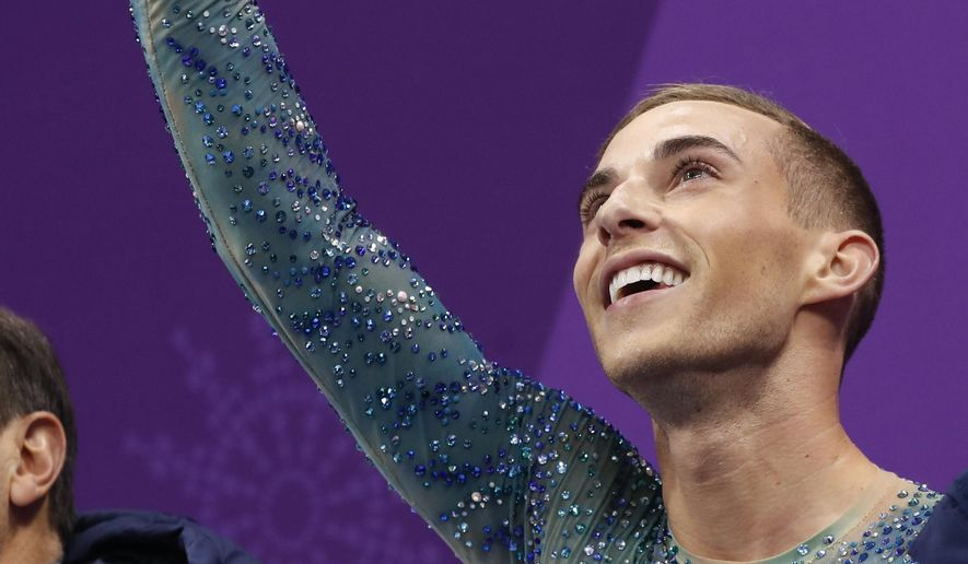 Adam Rippon of the United States reacts as his score is posted following his performance in the men's free figure skating final in the Gangneung Ice Arena at the 2018 Winter Olympics in Gangneung, South Korea, Saturday, Feb. 17, 2018. (AP Photo/Bernat Armangue) **FILE**