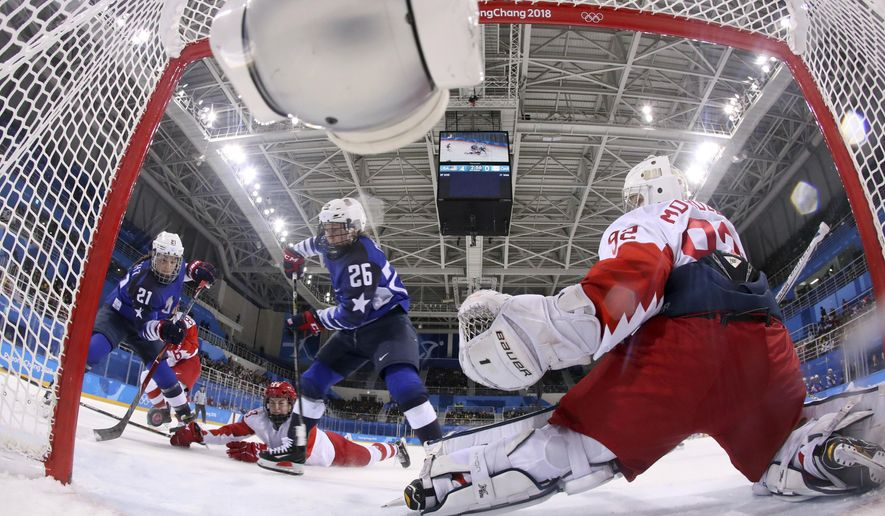 FILE - In this Feb. 13, 2018, file photo, Hilary Knight, of the United States, shoots against Russian athlete Nadezhda Morozova (92) during the second period of the preliminary round of the women's hockey game at the 2018 Winter Olympics in Gangneung, South Korea. The Americans are in the knockout round starting Monday, Feb. 19, with a semifinal against Finland, and they have spent the past couple practices trying to fine-tune their aim. (Bruce Bennett/Pool Photo via AP, File)