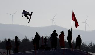 Asami Hirono, of Japan, flies through the air during training for the women's big air snowboard competition at the 2018 Winter Olympics in Pyeongchang, South Korea, Monday, Feb. 19, 2018. (AP Photo/Matthias Schrader)