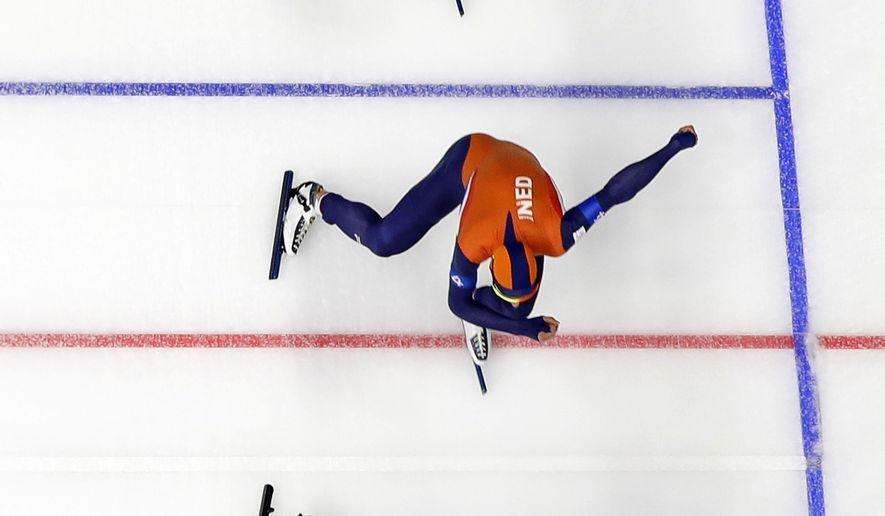 Team Netherlands with Sven Kramer, front, Jan Blokhuijsen, center, and Koen Verweij, rear, competes during the quarterfinals of the men's team pursuit speedskating race at the Gangneung Oval at the 2018 Winter Olympics in Gangneung, South Korea, Sunday, Feb. 18, 2018. (AP Photo/Eugene Hoshiko)