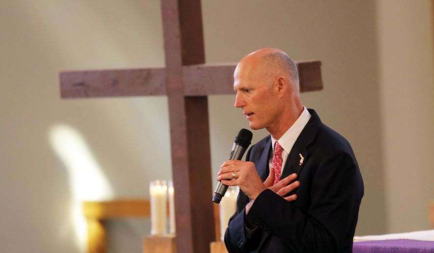 Florida Governor Rick Scott addresses the congregation during a Sunday service at the First United Methodist Church of Coral Springs, dedicated to the victims of the Wednesday mass shooting at nearby Marjory Stoneman Douglas High School, in Coral Springs, Fla., Sunday, Feb. 18, 2018. Nikolas Cruz, a former student, who is in custody, was charged with 17 counts of murder on Thursday. (AP Photo/Gerald Herbert)