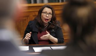 In this Feb. 14, 2018, photo, Sen. Tammy Duckworth, D-Ill., speaks to Goldman Sachs 10,000 Small Businesses Summit, on Capitol Hill, in Washington. Duckworth doesn't blend in, and that's the way she likes it. The decorated Iraqi War veteran who lost both legs when her helicopter was shot down is an Asian-American woman in the mostly-white, mostly-male and very fusty Senate. And now, with a baby due in April, the Illinois Democrat will be the first senator to give birth while in office. (AP Photo/Alex Brandon)