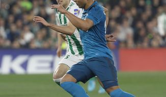 Real Madrid's Casemiro, right, and Betis', Bartra, challenge for the ball during La Liga soccer match between Betis and Real Madrid at the Villamarin stadium, in Seville, Spain, on Sunday, Feb. 18, 2018. (AP Photo/Miguel Morenatti)