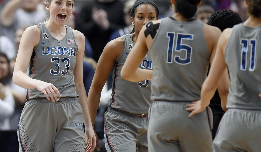 Connecticut's Katie Lou Samuelson (33) reacts to teammate Gabby Williams (15) during the second half an NCAA college basketball game against Temple, Sunday, Feb. 18, 2018, in Hartford, Conn. (AP Photo/Jessica Hill)