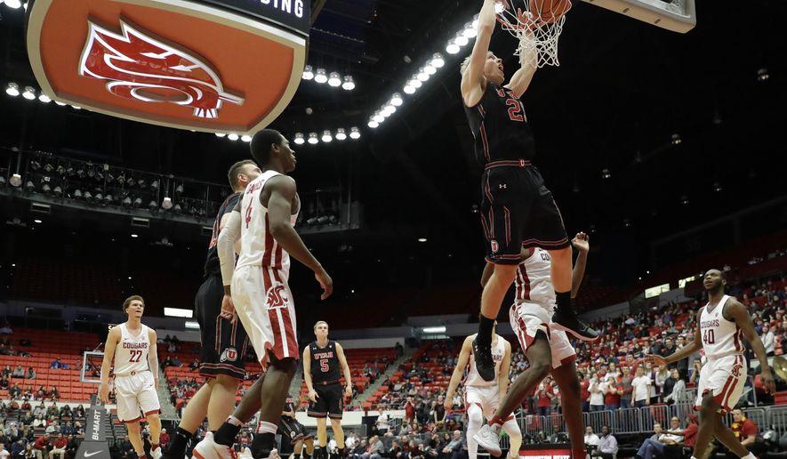Utah forward Tyler Rawson dunks against Washington State during the second half of an NCAA college basketball game Saturday, Feb. 17, 2018, in Pullman, Wash. Utah won 77-70. (AP Photo/Ted S. Warren)
