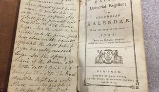 In this Feb. 14, 2018 photo, an old almanac that contained a lock of George Washington's hair lay open on a table at Union College in Schenectady, N.Y. The hair was found by a Union College librarian who was cataloging books in the college's archival collection. (AP Photo/Mary Esch)
