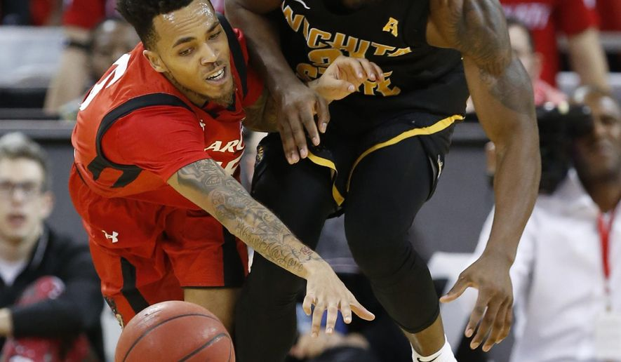 Cincinnati guard Cane Broome, left, and Wichita State forward Darral Willis Jr. collide while going for the ball during the first half of an NCAA college basketball game, Sunday Feb. 18, 2018, in Highland Heights, Ky. (AP Photo/Gary Landers)