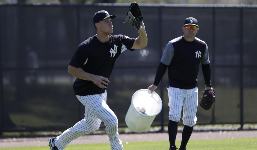 New York Yankees' Aaron Judge does drills in the outfield at baseball spring training camp, Sunday, Feb. 18, 2018, in Tampa, Fla. (AP Photo/Lynne Sladky)