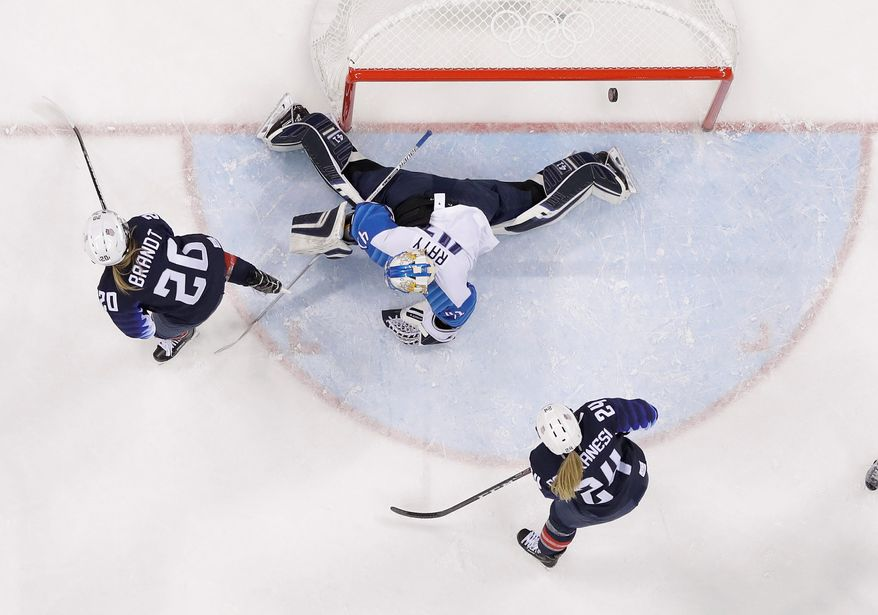 American Hannah Brandt watches a second period goal sail underneath Finland goalkeeper Noora Raty in Monday's Olympic semifinal victory. (Associated Press)