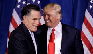 Donald Trump greets Republican presidential candidate, former Massachusetts Gov. Mitt Romney, after announcing his endorsement of Romney during a news conference, Thursday, Feb. 2, 2012, in Las Vegas.  (AP Photo/Julie Jacobson) ** FILE **