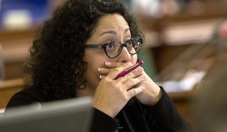 "FILE - In this Aug. 18, 2016 file photo, Assemblywoman Cristina Garcia, D-Bell Gardens, watches as the votes are posted for a measure before the Assembly in Sacramento, Calif. California law requires lawmakers and legislative staff attend sexual harassment training every two years, just as private-sector employees in supervisory roles do. ""Some people do take it seriously, and some people are on their phones, some people are cracking jokes,"" said Garcia, chair of the Legislative Women's Caucus. ""I would say the large majority of people are not as attentive."" (AP Photo/Rich Pedroncelli, File)"