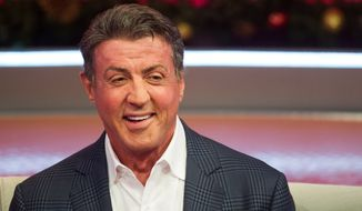 "Sylvester Stallone appears on BET's ""106 & Park"" on Monday, Dec. 16, 2013 in New York. (Photo by Charles Sykes/Invision/AP)"