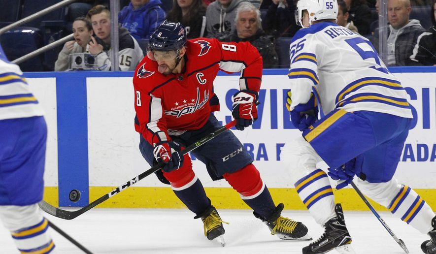 Buffalo Sabres defenseman Rasmus Ristolainen (55) defends against Washington Capitals forward Alex Ovechkin (8) during the first period of an NHL hockey game, Monday, Feb. 19, 2018, in Buffalo, N.Y. (AP Photo/Jeffrey T. Barnes)