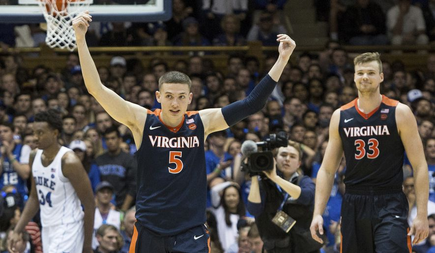 FILE - In this Jan. 27, 2018, file photo, Virginia's Kyle Guy (5) and Jack Salt (33) walk off the court following a victory in an NCAA college basketball game against Duke, in Durham, N.C. The Cavaliers remained at No. 1 in Monday's, Feb. 19, 2018, latest AP Top 25 poll, earning 42 of 65 first-place votes. (AP Photo/Ben McKeown, File)