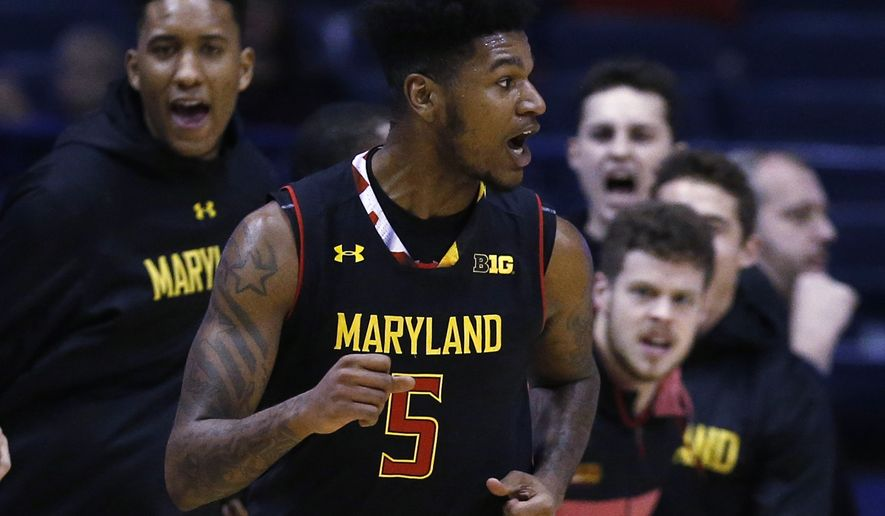 Maryland guard Dion Wiley (5) celebrates a basket against Northwestern during the second half of an NCAA college basketball game Monday, Feb. 19, 2018, in Rosemont, Ill. (AP Photo/Jim Young)