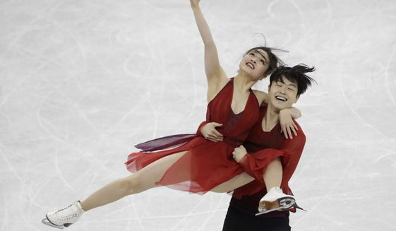Maia Shibutani and Alex Shibutani of the United States perform during the ice dance, free dance figure skating final in the Gangneung Ice Arena at the 2018 Winter Olympics in Gangneung, South Korea, Tuesday, Feb. 20, 2018. (AP Photo/Bernat Armangue)