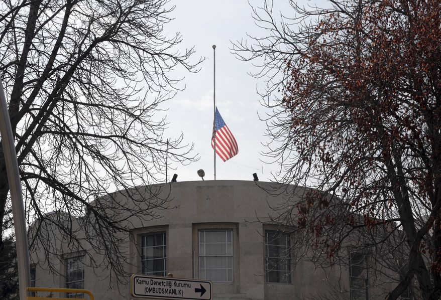 "The U.S. Embassy's flag flies at half-mast in respect for the Florida school shooting victims in Ankara, Turkey, Monday, Feb. 19, 2018. Municipality workers on Monday took down the street sign for Nevzat Tandogan Street where the U.S. Embassy is located and replaced it with one that reads ""Olive Branch Street."" (AP Photo/Burhan Ozbilici)"