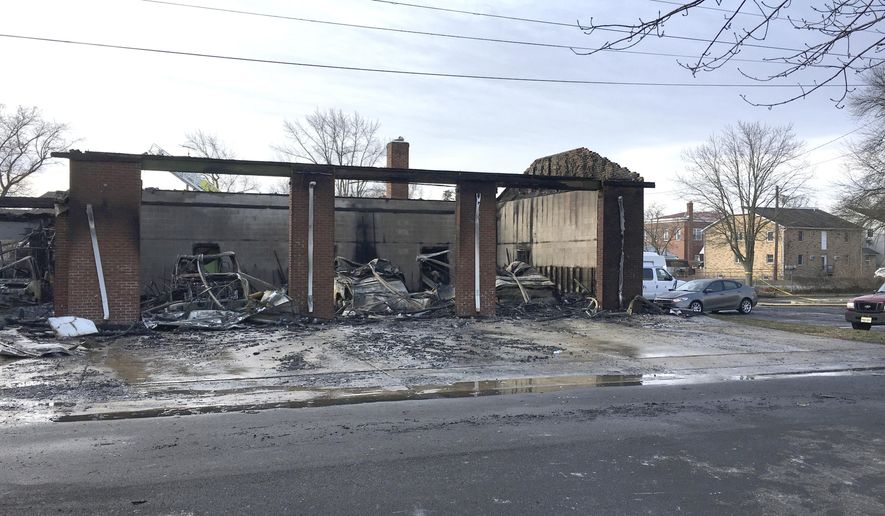 Authorities say a fast-moving fire gutted an ambulance squad's building in New Jersey, destroying five ambulances and causing at least $2 million in damage overall.The fire at the American Legion Ambulance Association, in Woodstown, N.J., broke out around 4 a.m. Monday, Feb. 19, 2018, and was extinguished about two hours later. Officials say oxygen tanks inside some of the squad's ambulances exploded shortly after the fire began, helping the flames to quickly spread. (Matt Gray /NJ Advance Media via AP)