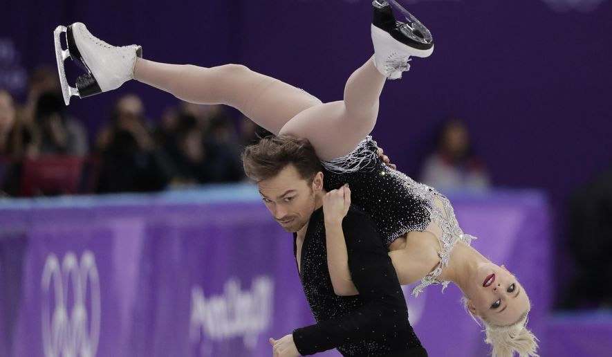 Penny Coomes and Nicholas Buckland of Britain perform during the ice dance, short dance figure skating in the Gangneung Ice Arena at the 2018 Winter Olympics in Gangneung, South Korea, Monday, Feb. 19, 2018. (AP Photo/Julie Jacobson)