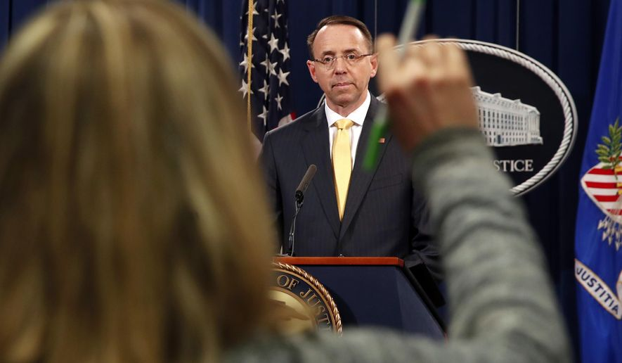 A reporter raises her hands to ask a question of Deputy Attorney General Rod Rosenstein, after he announced that the office of special counsel Robert Mueller says a grand jury has charged 13 Russian nationals and several Russian entities, Friday, Feb. 16, 2018, in Washington. The defendants are accused of violating U.S. criminal laws to interfere with American elections and the political process. (AP Photo/Jacquelyn Martin)