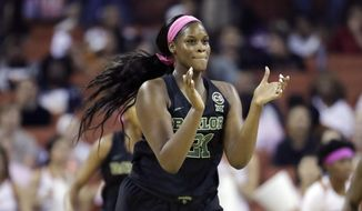 Baylor center Kalani Brown (21) celebrates a score against Texas during the first half of an NCAA college basketball game, Monday, Feb. 19, 2018, in Austin, Texas. (AP Photo/Eric Gay)