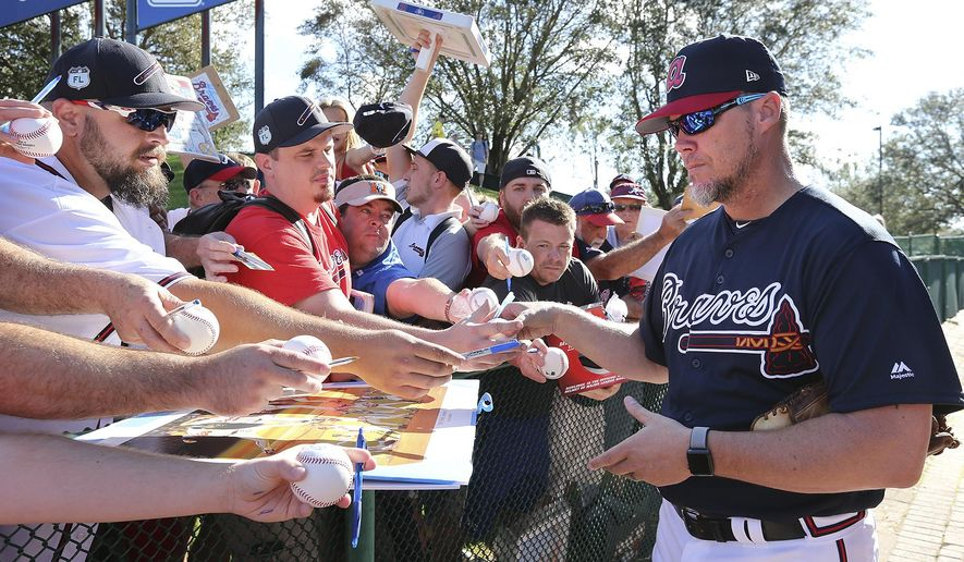 Atlanta Braves Hall of Fame baseball player Chipper Jones signs autographs at baseball spring training in Kissimmee, Fla., Monday, Feb. 19, 2018. (Curtis Compton/Atlanta Journal-Constitution via AP)
