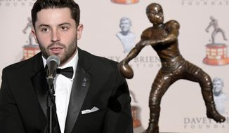 The Davey O'Brien National Quarterback Award winner Baker Mayfield speaks during a news conference at the Fort Worth Club in Fort Worth, Texas, Monday, Feb. 19, 2018. (Max Faulkner/Star-Telegram via AP)