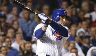 FILE - In this Aug. 29, 2017, file photo, Chicago Cubs' Anthony Rizzo doubles off Pittsburgh Pirates starting pitcher Chad Kuhl during the sixth inning of a baseball game, in Chicago. Rizzo is set to rejoin the club for its first full-squad workout after returning to Florida to support victims of last week's deadly shooting at his former high school. (AP Photo/Charles Rex Arbogast, File)
