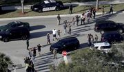 In a Wednesday, Feb. 14, 2018, file photo, students hold their hands in the air as they are evacuated by police from Marjory Stoneman Douglas High School in Parkland, Fla., after a shooter opened fire on the campus. Frustration is mounting in the medical community as the Trump administration again points to mental illness in response to yet another mass shooting. (Mike Stocker/South Florida Sun-Sentinel via AP, File)