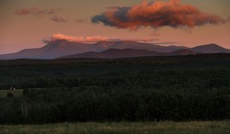 FILE - The Aug. 7, 2017 file photo shows Mount Katahdin at dawn, just west of the Katahdin Woods and Waters National Monument, a site administered by the U.S. Interior Department near Patten, Maine. A year of upheaval at the U.S. Interior Department has seen dozens of senior staff members reassigned and key leadership positions left unfilled, rules considered burdensome to industry shelved, and repeated complaints that dissenting views have been sidelined. (AP Photo/Robert F. Bukaty, File)