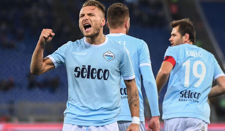 Lazio's Ciro Immobile celebrates after scoring a goal during the Italian Serie A soccer match between Lazio and Verona at the Olympic stadium in Rome, Italy, Monday, Feb. 19, 2016. (Alessandro Di Meo/ANSA via AP)
