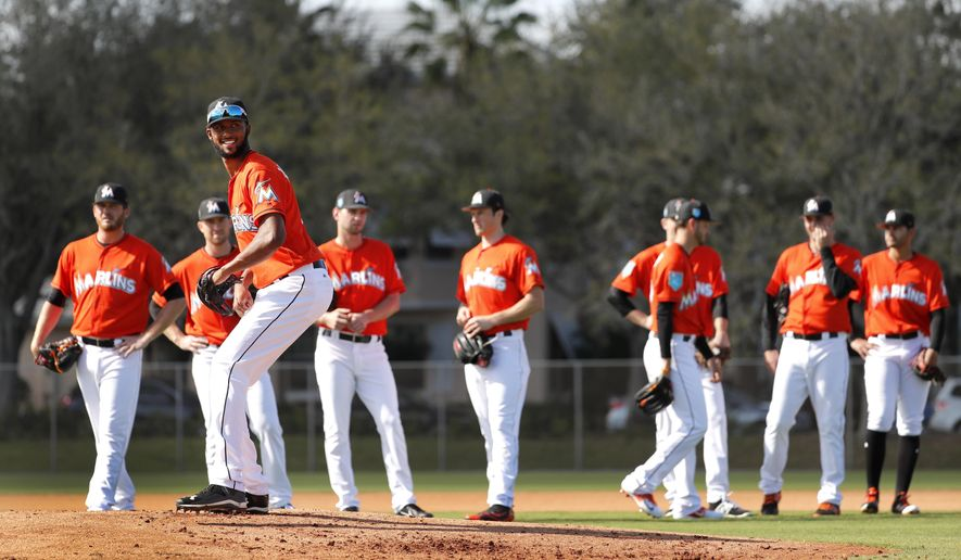 Derek jeters blueprint begins to take shape at marlins camp miami marlins pitcher sandy alcantara stands on the mound as teammates wait their turn during a malvernweather Images