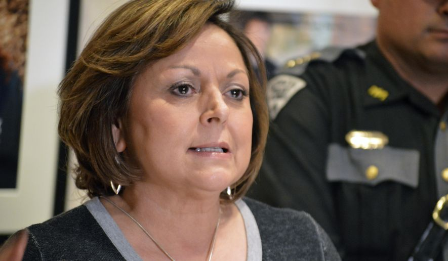 FILE - In this Feb. 15, 2018 file photo New Mexico Gov. Susana Martinez, a Republican, speaks to reporters outside her office in Santa Fe, N.M. The rocky relationship between Martinez and state lawmakers is coming to a close as both sides ponder what could have been. Democratic leaders say they wish there was better communication with the Republican governor and wonder if they could have done more. Martinez says her only regret is that lawmakers didn't pass more of her legislation during her eight years in office.(AP Photo/ Russell Contreras,File)