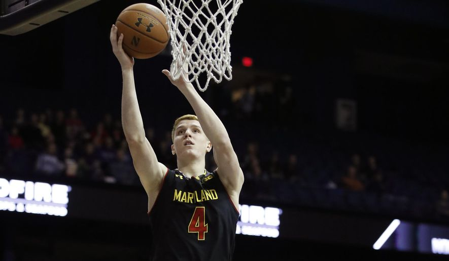 Maryland guard Kevin Huerter (4) goes to the basket against Northwestern guard Scottie Lindsey (20) during the first half of an NCAA college basketball game Monday, Feb. 19, 2018, in Rosemont, Ill. (AP Photo/Jim Young)