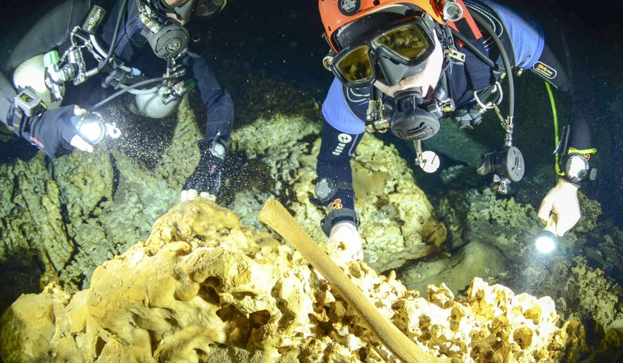"This undated photo released by Mexico's National Anthropology and History Institute (INAH), shows divers from the Great Mayan Aquifer project exploring the Sac Actun underwater cave system where Mayan and Pleistocene bones and cultural artifacts have been found submerged, near Tulum, Mexico. Mexican experts said Monday, Feb. 19, 2018, that the recently mapped Sac Actun cave system ""is probably the most important underwater archaeological site in the world,"" but is threatened by pollution.  (Jan Arild Aaserud/Great Mayan Aquifer Project-INAH via AP)"