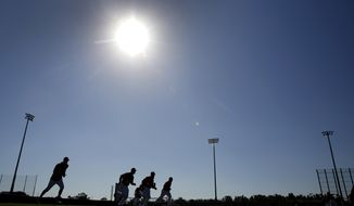 Members of the Washington Nationals run sprints during spring training baseball practice Saturday, Feb. 17, 2018, in West Palm Beach, Fla. (AP Photo/Jeff Roberson)