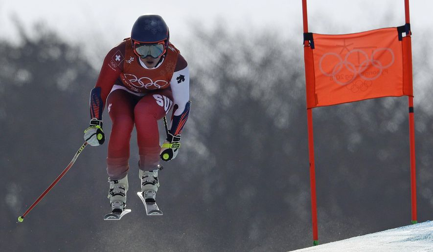Switzerland's Lara Gut makes a jump during women's downhill training at the 2018 Winter Olympics in Jeongseon, South Korea, Monday, Feb. 19, 2018. (AP Photo/Luca Bruno)