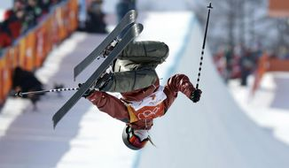 Cassie Sharpe, of Canada, jumps during the women's halfpipe final at Phoenix Snow Park at the 2018 Winter Olympics in Pyeongchang, South Korea, Tuesday, Feb. 20, 2018. (AP Photo/Kin Cheung)