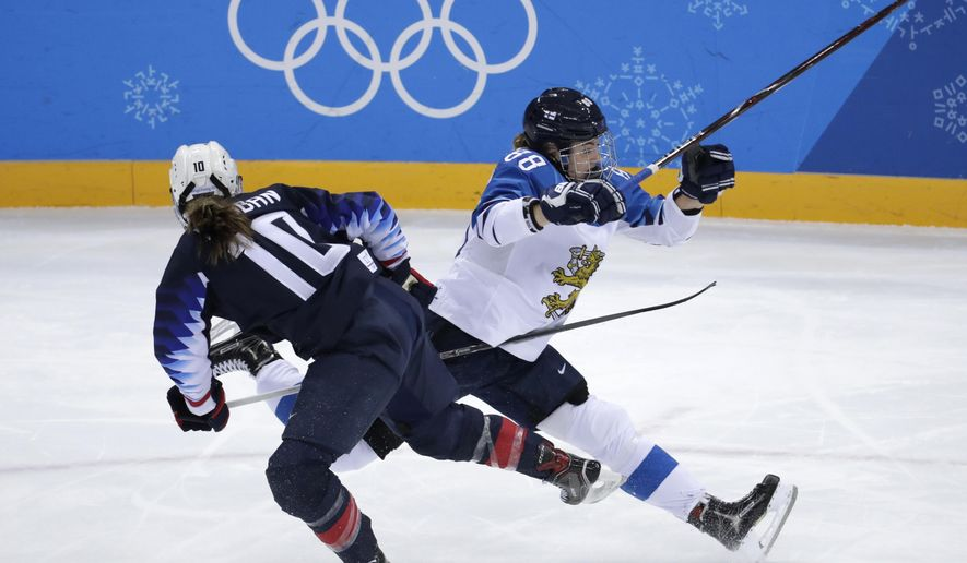 Meghan Duggan (10), of the United States, and Ronja Savolainen, of Finland, collide during the first period of the semifinal round of the women's hockey game at the 2018 Winter Olympics in Gangneung, South Korea, Monday, Feb. 19, 2018. (AP Photo/Julio Cortez)
