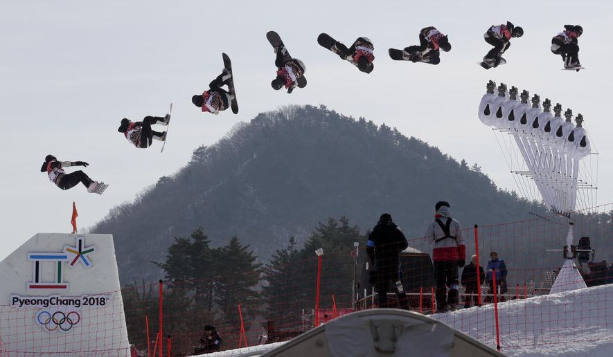 In this multiple exposure image Laurie Blouin, of Canada, jumps during qualification for the women's big air snowboard competition at the 2018 Winter Olympics in Pyeongchang, South Korea, Monday, Feb. 19, 2018. (AP Photo/Dmitri Lovetsky)