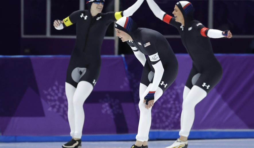 Team U.S.A. with Heather Bergsma, center, Brittany Bowe, right, and Mia Manganello , left, celebrates after the quarterfinals of the women's team pursuit speedskating race at the Gangneung Oval at the 2018 Winter Olympics in Gangneung, South Korea, Monday, Feb. 19, 2018. (AP Photo/Petr David Josek)