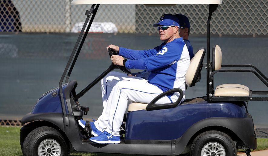 Kansas City Royals manager Ned Yost watches from his golf cart during a baseball spring training workout, Saturday, Feb. 17, 2018, in Surprise, Ariz. (AP Photo/Charlie Neibergall)