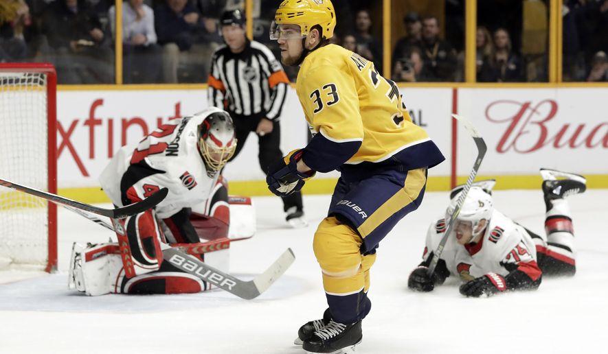 Nashville Predators left wing Viktor Arvidsson, of Sweden, scores a goal against Ottawa Senators goaltender Craig Anderson, left, in the second period of an NHL hockey game Monday, Feb. 19, 2018, in Nashville, Tenn. (AP Photo/Mark Humphrey)