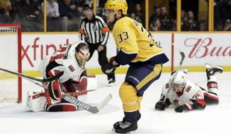 Nashville Predators left wing Viktor Arvidsson, of Sweden, scores a goal against Ottawa Senators goaltender Craig Anderson, left, in the second period of an NHL hockey game Monday, Feb. 19, 2018, in Nashville, Tenn. (AP Photo/Mark Humphrey)