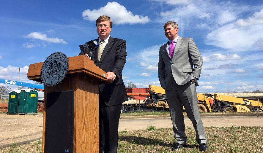 Mississippi Lt. Gov. Tate Reeves and state Sen Joey Fillingane discuss a plan to fund infrastructure improvements on Monday, Feb. 19, 2018, in Jackson, Miss. Reeves says he wants to borrow or divert more than $1 billion over the next six years. (AP Photo/Jeff Amy)