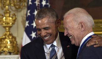 President Barack Obama laughs with Vice President Joe Biden during a ceremony in the State Dining Room of the White House in Washington, Thursday, Jan. 12, 2017. (AP Photo/Susan Walsh) ** FILE **