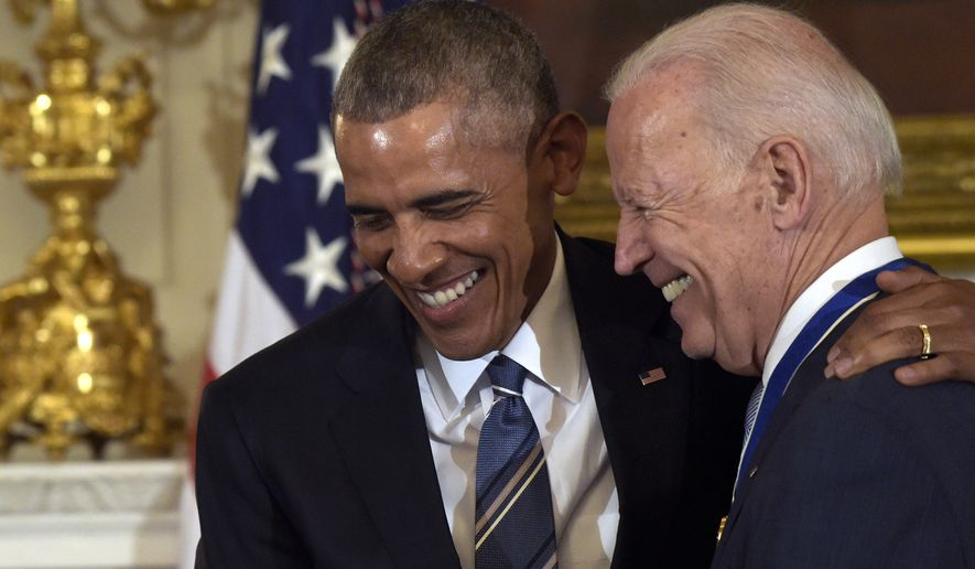 President Barack Obama laughs with Vice President Joe Biden during a ceremony in the State Dining Room of the White House in Washington, Thursday, Jan. 12, 2017.  (AP Photo/Susan Walsh)
