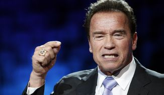 Former California Gov. Arnold Schwarzenegger delivers his speech at the One Planet Summit, in Boulogne-Billancourt, near Paris, France, Tuesday, Dec. 12, 2017. World leaders, investment funds and energy magnates promised to devote new money and technology to slow global warming at a summit in Paris that President Emmanuel Macron hopes will rev up the Paris climate accord that U.S. President Donald Trump has rejected. (AP Photo/Christophe Ena)